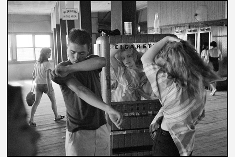 "Leica: © Bruce Davidson: ""USA. New York City. 1959. Brooklyn Gang. Coney Island. Cathey fixing her hair in a cigarette machine mirror."""